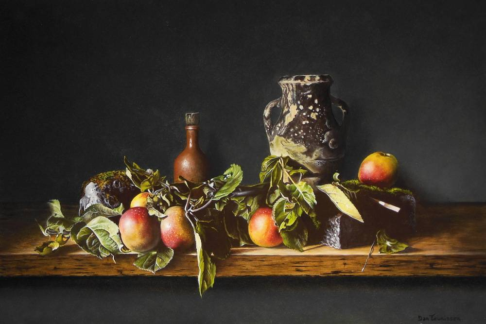 Apples with mossy stones and jug