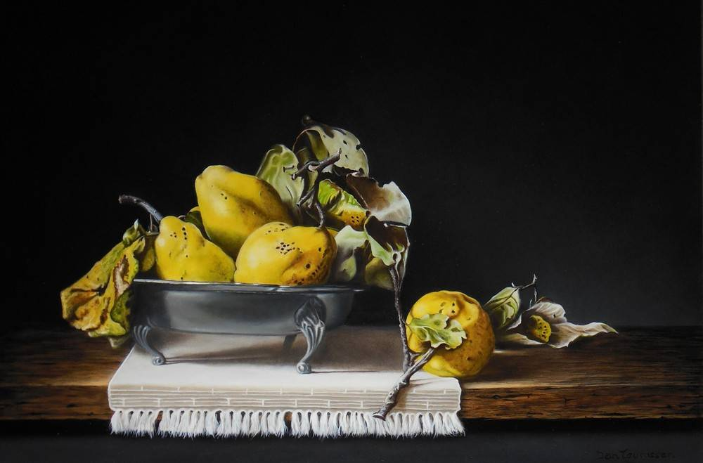 Quinces in tin bowl